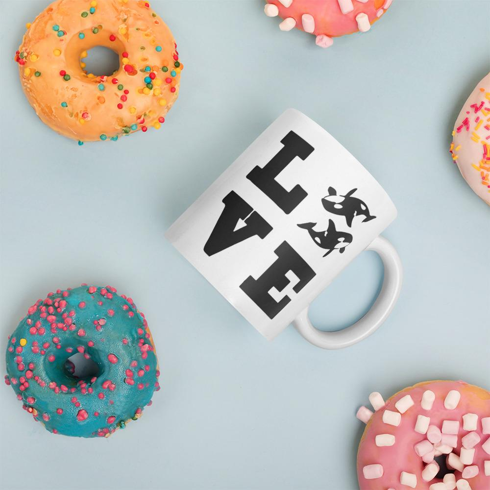 Orca Shop: Love Orca coffee mug amongst donuts by Wildlife Collections.